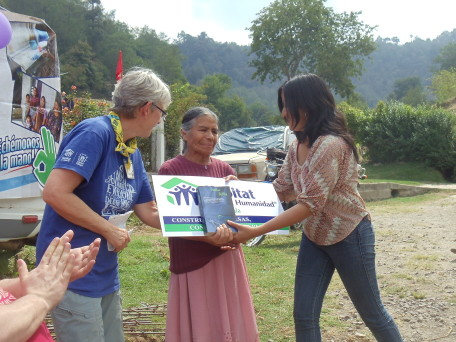 Elizabeth and aid recipient in Guatemala